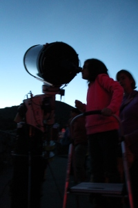 Sophia looking at Jupiter and it's moons through the telescope near the top of Mauna Kea.
